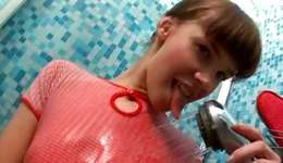 Arousing sluttish harlot is showering her gorgeous spicy body