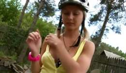 Teen blonde riding a bike and flashing her bodily and fine scoops